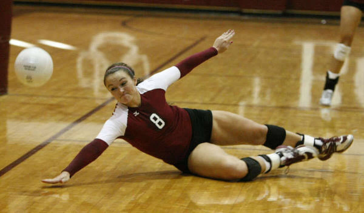 Cy-Fair senior Madison Smith makes a diving attempt at a ball that gets away from her teammate.