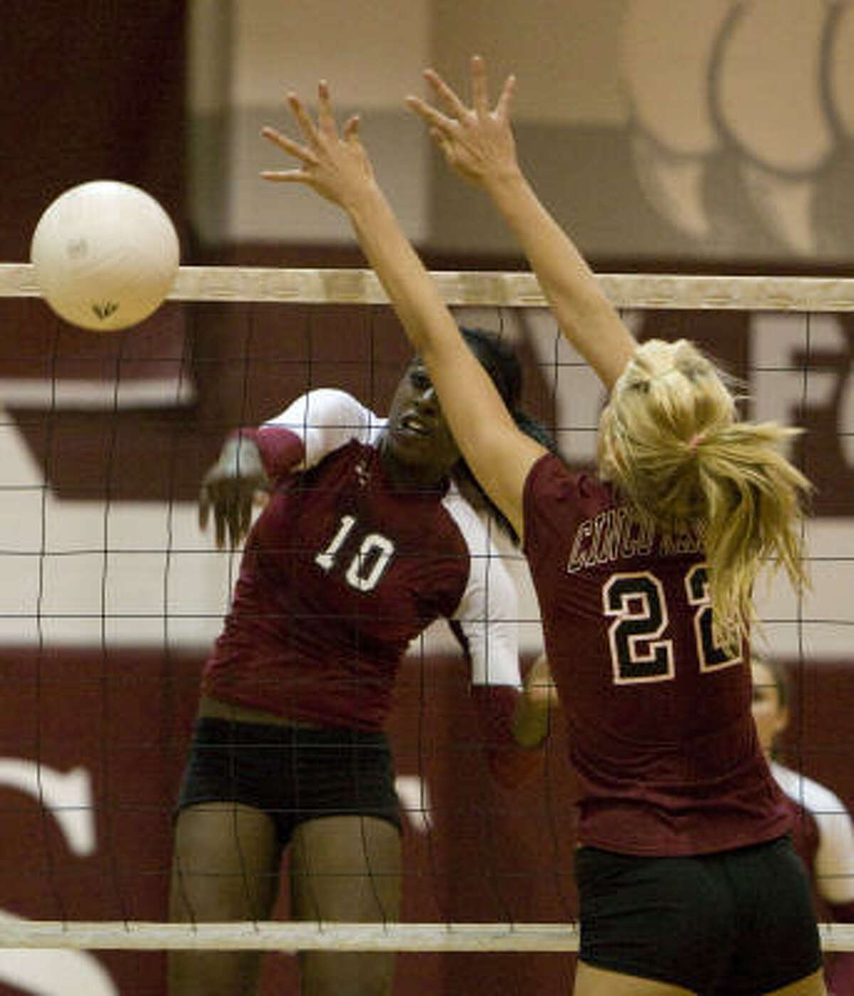 Cy-Fair senior Chiney Ogwumike (10) gets a kill past the outstreched arms of Cinco Ranch's Jennifer Sanders.
