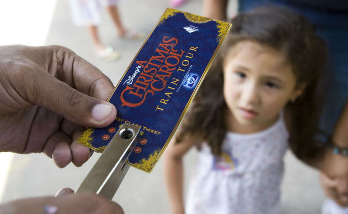 Lyann Marrero has her ticket punched as she waits to tour Disney's A Christmas Carol train.