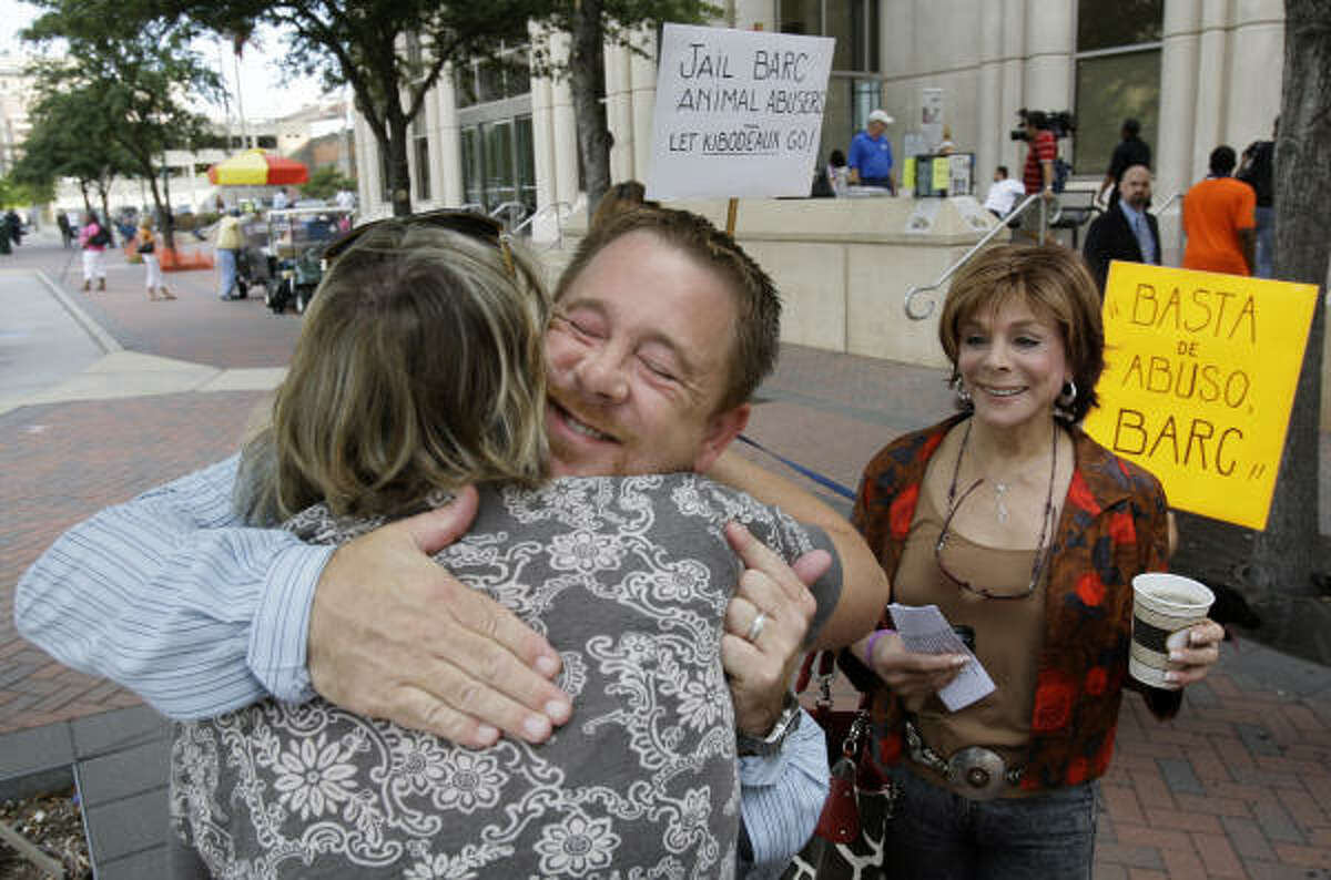 Shelby Kibodeaux (with supporters Lynne Jennings of Huffman and Jewell Maida, right, of Houston) meet outside the Harris County Criminal Courts building on Monday. Kibodeaux was a volunteer at city's animal-control facility, the Bureau of Animal Regulation and Care, and was recently charged with filing a false police report after contacting city officials with his concerns about an incident at BARC. The case brought protesters to the courts building to demand reform.