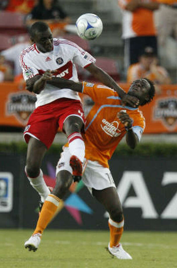 Aug. 9: Dynamo 3 - Chicago Fire 2Dynamo forward Kei Kamara, right, and Chicago Fire defender Bakary Soumare battle for the ball during the first half. Photo: Julio Cortez, Chronicle