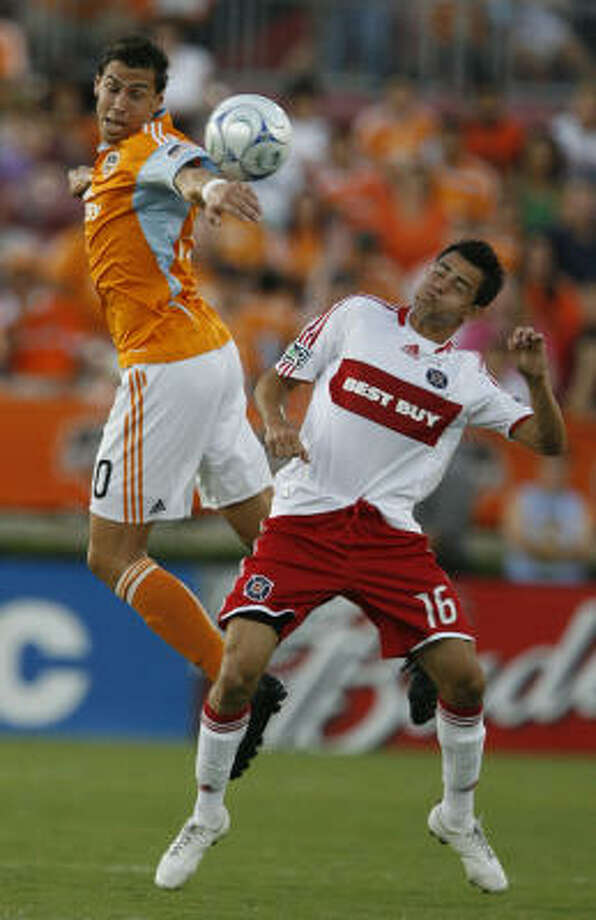 Houston Dynamo defender Geoff Cameron, left, and Chicago Fire midfielder Marco Pappa battle for the ball during the first half of a MLS Soccer game against the Houston Dynamo at Robertson Stadium on Sunday, Aug. 9, 2009, in Houston. (AP Photo/Houston Chronicle,Julio Cortez)  ** MANDATORY CREDIT ** Photo: Julio Cortez, AP