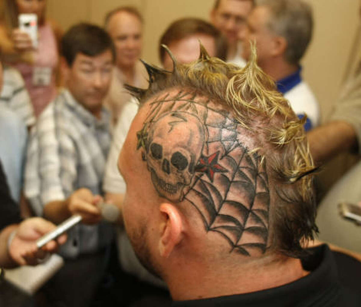 Texas Tech offensive lineman Brandon Carter showed off his frightful tatoo and Mohawk at media day.
