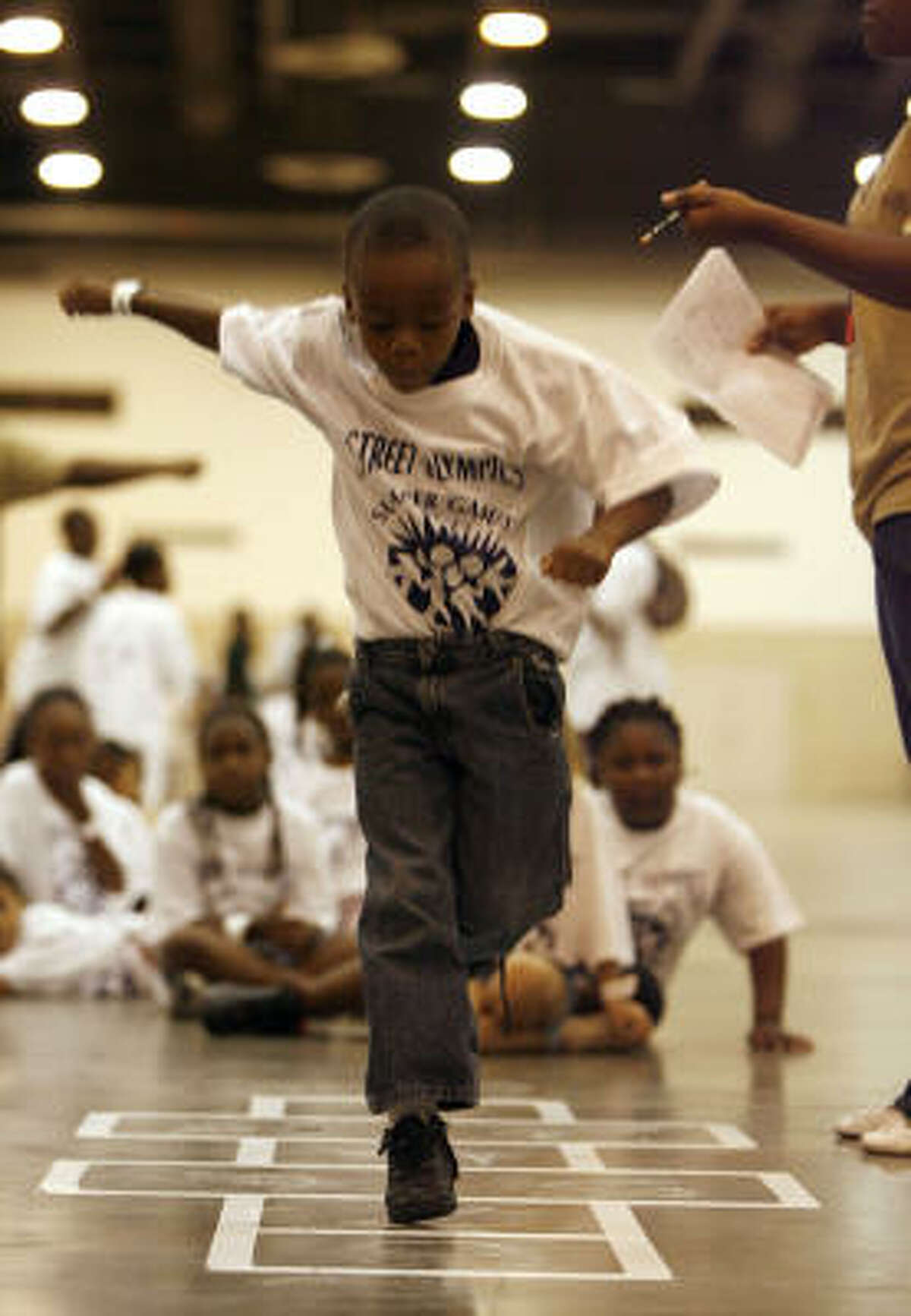 Quetin Humphrey, 5, competes in the hopscotch event during the 23rd annual Harris County Street Olympics.