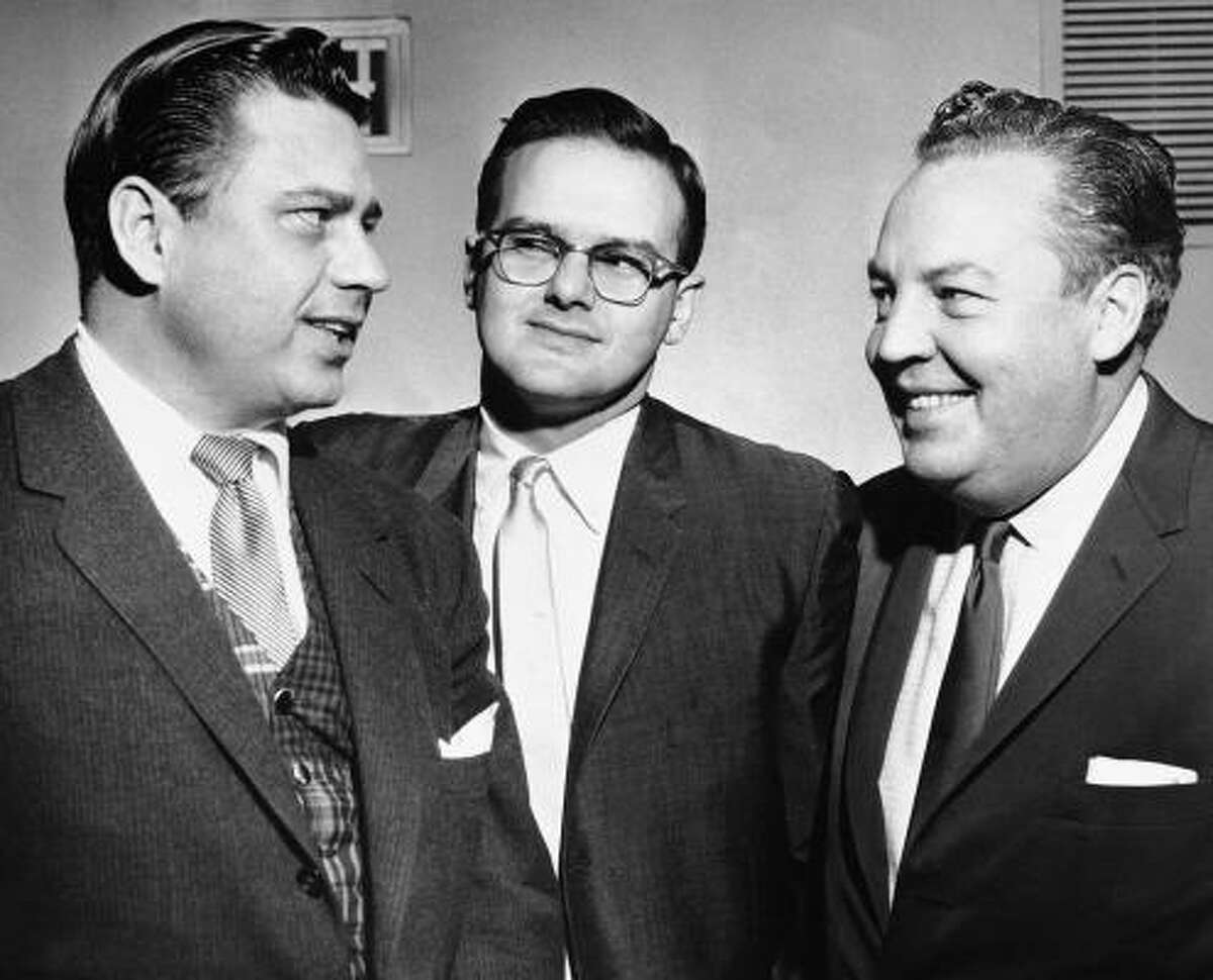 FILE -- This Jan. 26, 1960, file photo shows American Football League president Lamar Hunt, center, flanked by Bud Adams, left, owner of the Houston AFL team, and Harry Wismer, owner of the New York AFL team, in Dallas. The mere mention of the name Bud Adams in Houston still riles fans angry that he relocated their beloved Oilers to Tennessee in 1997. The franchise is celebrating its 50th anniversary with Adams still in charge of the team he started along with co-founding the AFL.