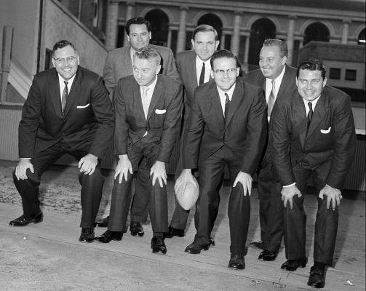 Representatives of the American Football League posing in New York City in 1959. Posing in the front row from left are: Robert L. Howsam, Denver, Colo.; Max Winter, Minneapolis-St. Paul, Minn.; and league co-founders Lamar Hunt, Dallas and Bud Adams Jr., Houston. In the back row: Barron Hilton, Los Angeles; Ralph C. Wilson Jr., Buffalo, N.Y.; and Harry Wismer, New York.