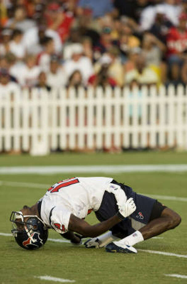 Texans wide receiver Jacoby Jones bends over backward as he dances to music by Texas Southern University's Ocean of Soul band. Photo: Brett Coomer, Chronicle