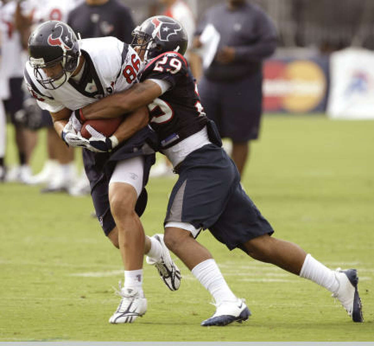 Texans tight end James Casey, a fifth-round selection from Rice, is hit by rookie cornerback Glover Quin.