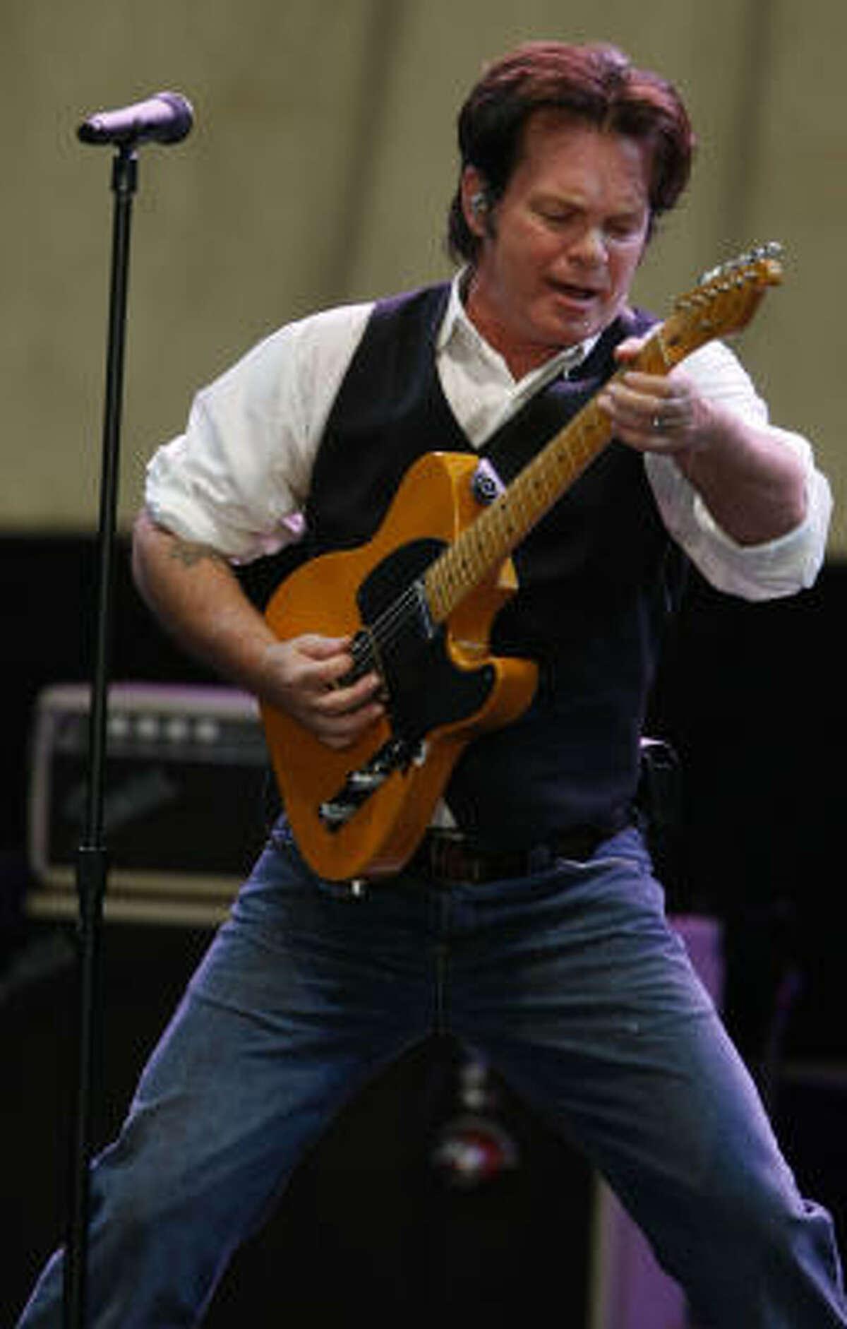John Mellencamp strums out a tune.