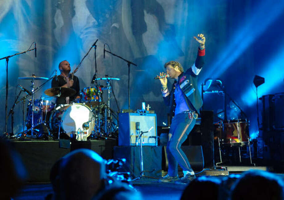 Coldplay drummer Will Champion, left, and Chris Martin put on an incredible performance at the Woodlands Pavillion Wednesday night. Photo: Tre' Ridings, For The Chronicle