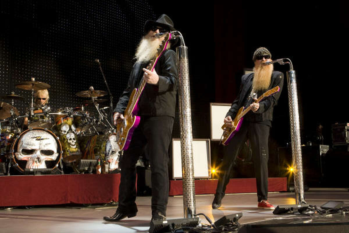 ZZ Top's Dusty Hill, left, and Billy F. Gibbons and Frank Beard, on drums, perform during their concert at the Cynthia Woods Mitchell Pavilion. Read the review here.