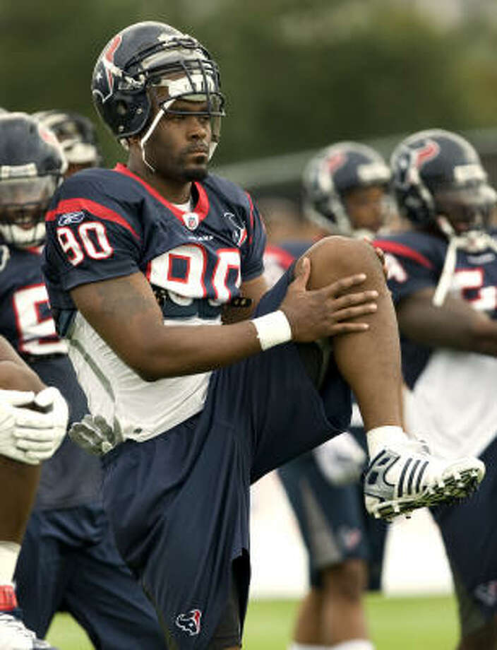 Defensive end Mario Williams stretches as the Texans prepare to go through their first workout in pads. Photo: Brett Coomer, Chronicle