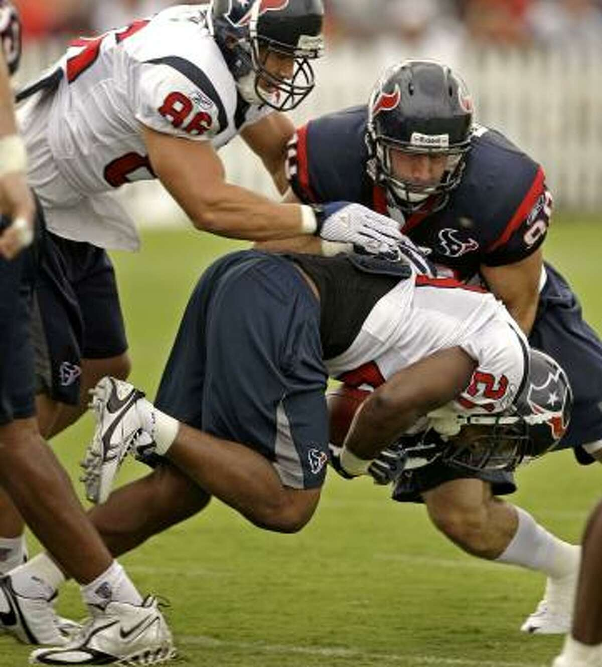 Defensive end Connor Barwin hits running back Ryan Moats.