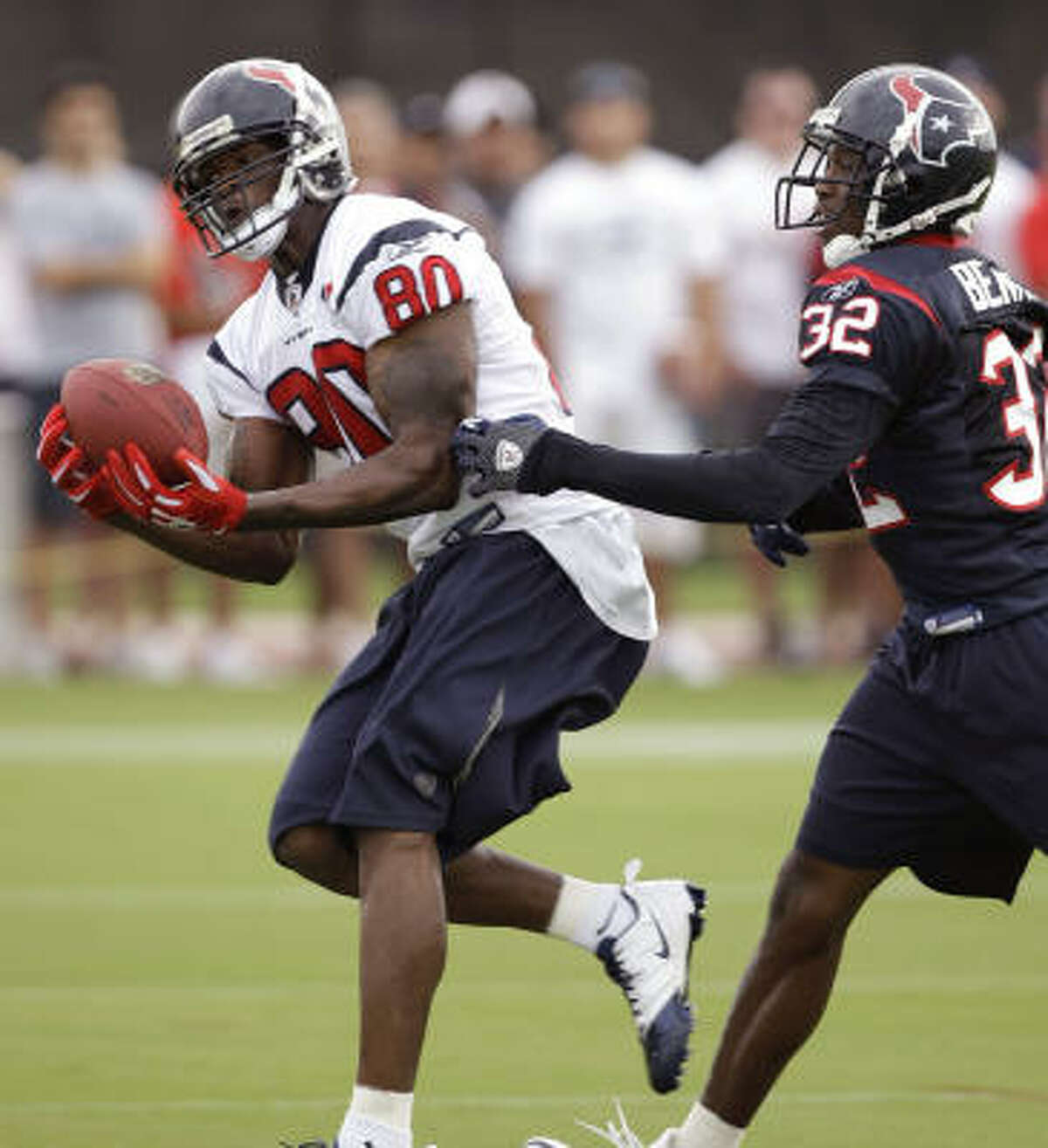 Wide receiver Andre Johnson, left, reaches out to make a reception past cornerback Fred Bennett.