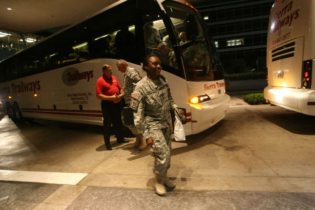 Members of the 712th Military Police Company, Combat Support, of the Texas National Guard based in Baytown arrive at the Hilton Americas where family members wait to greet them for the first time after almost a year's deployment in Iraq in support of Operation Iraqi Freedom.