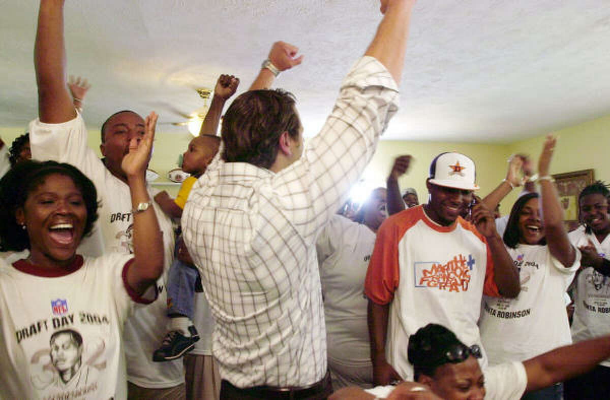 2004 Family and friends gathered at Dunta Robinson's home in Athens, Ga., to support him on draft day. He got a call in the first round delivering the news he'd been drafted by the Texans with the 10th overall pick.