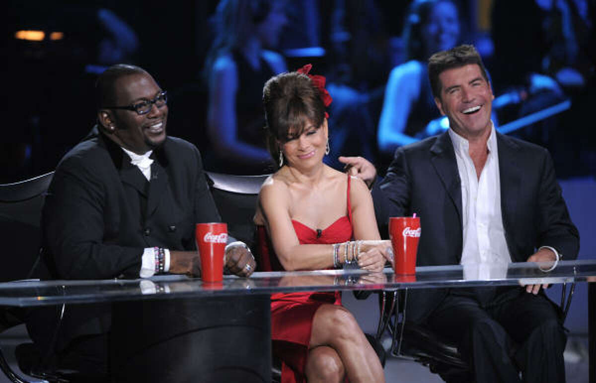 Abdul has taken a lot of ribbing from her co-hosts over the years. She's been a good sport, for the most part. In this April 6, 2008, photo, Randy Jackson, left, Abdul, center, and Simon Cowell are onstage at the Idol Gives Back fundraising special of American Idol in Los Angeles.