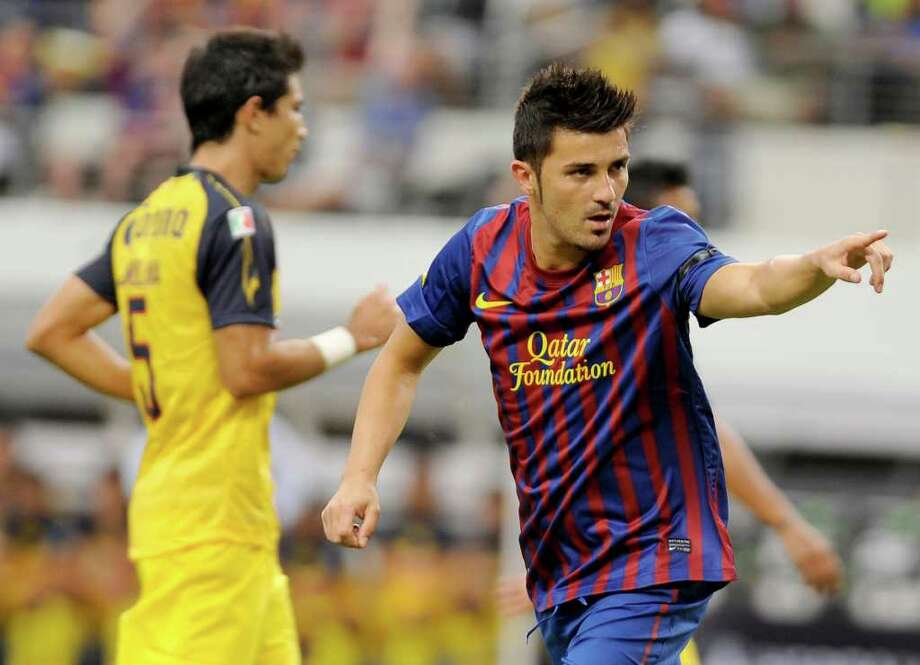 FC Barcelona's David Villa, right, celebrates after his goal in the first half of a soccer match agaisnt Club America, Saturday, Aug. 6, 2011, in Arlington, Texas. (AP Photo/Matt Strasen) Photo: Matt Strasen, FRE / FR170476 AP