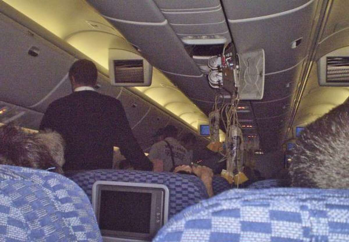 Passenger Camila Machado took a photo of the damage inside Continental Airlines Flight 128.