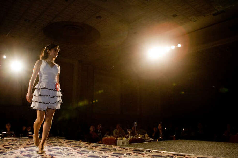 Jessica Chong walks the runway. Photo: R. Clayton McKee, For The Chronicle