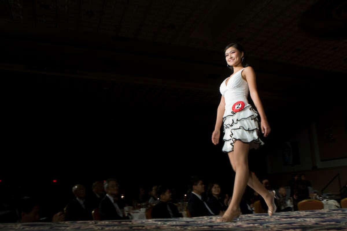 Li Yi walks the runway.