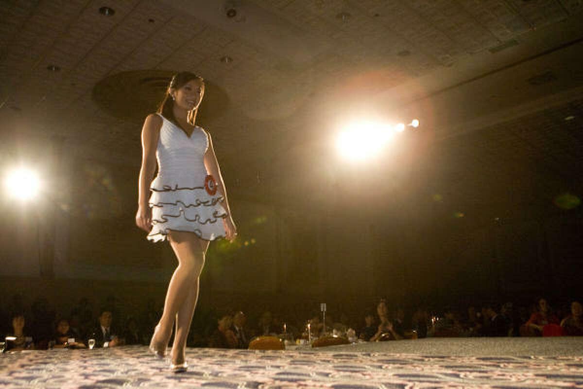 Angela Wang walks the runway.