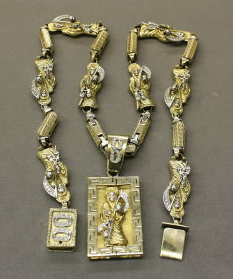 Jewelry and other lavish items seized from criminals are hitting the auction block. Among them is a diamond and gold Santa Muerte necklace (full story).