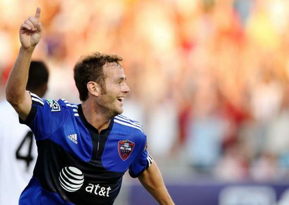 MLS All-Star and Dynamo midfielder Brad Davis celebrates after scoring against Everton FC in the first half. Teammate Stuart Holden assisted Davis' goal.