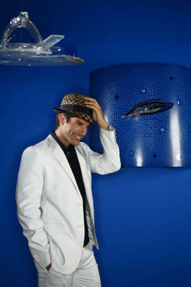 Bryan Mitchell, The Neal Hamil Agency, wears a hat from Neiman Marcus/Makins New York/$180; jacket from Neiman Marcus/Theory/$495; shirt from Neiman Marcus/Theory/$165; pants from Neiman Marcus/Theory/$235. Photo: Michael Paulsen, Houston Chronicle