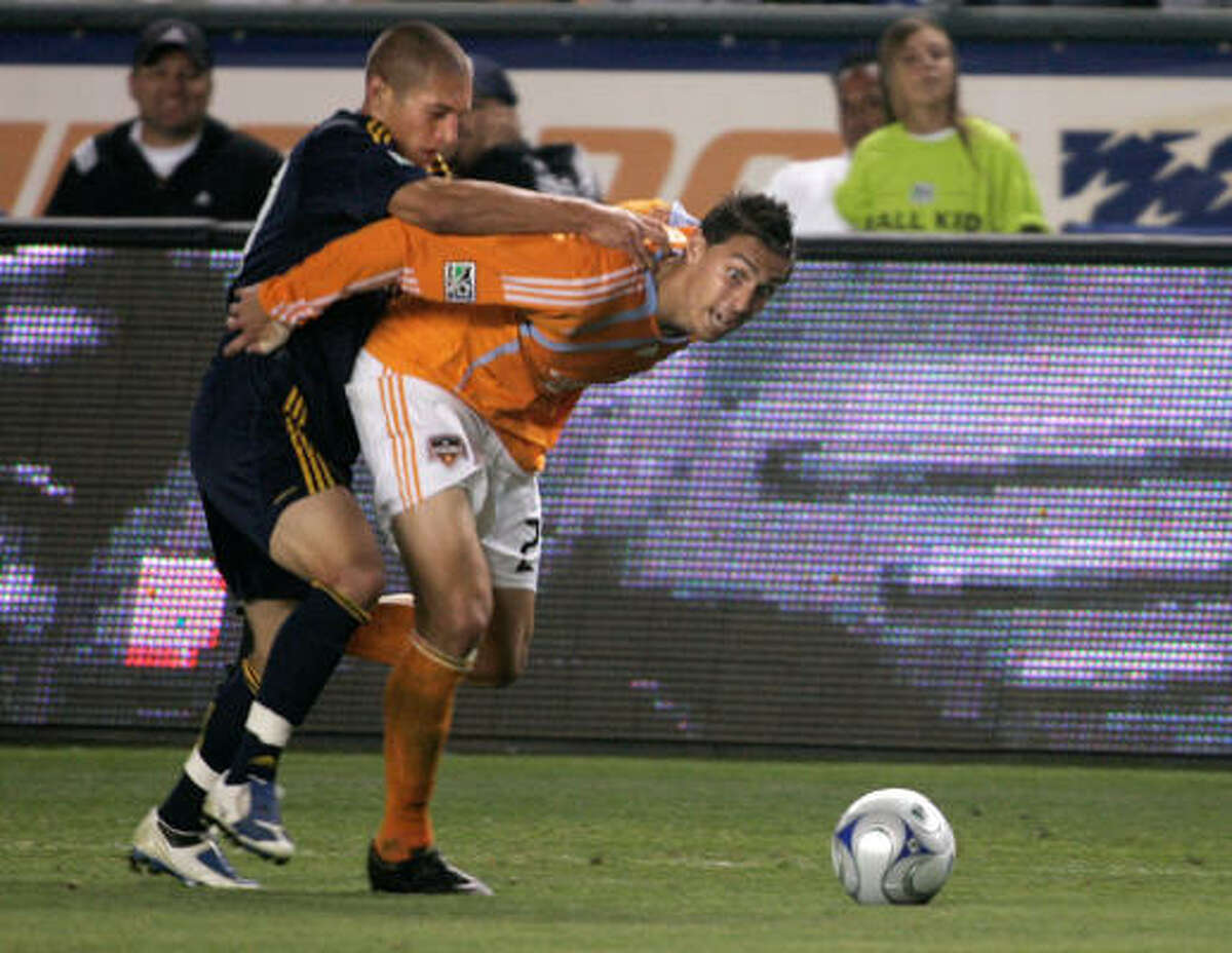 Defender Geoff Cameron, right, has provided two assists in 18 games played for the Houston Dynamo this season.