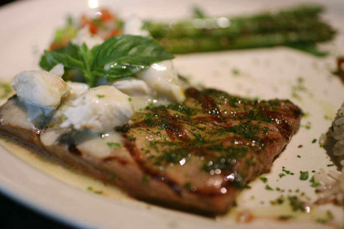 Fernando Echeverria, owner of Latin Cuisine, 14135 Southwest Freeway, made the Steak Wallace with rosemary and lump crab.