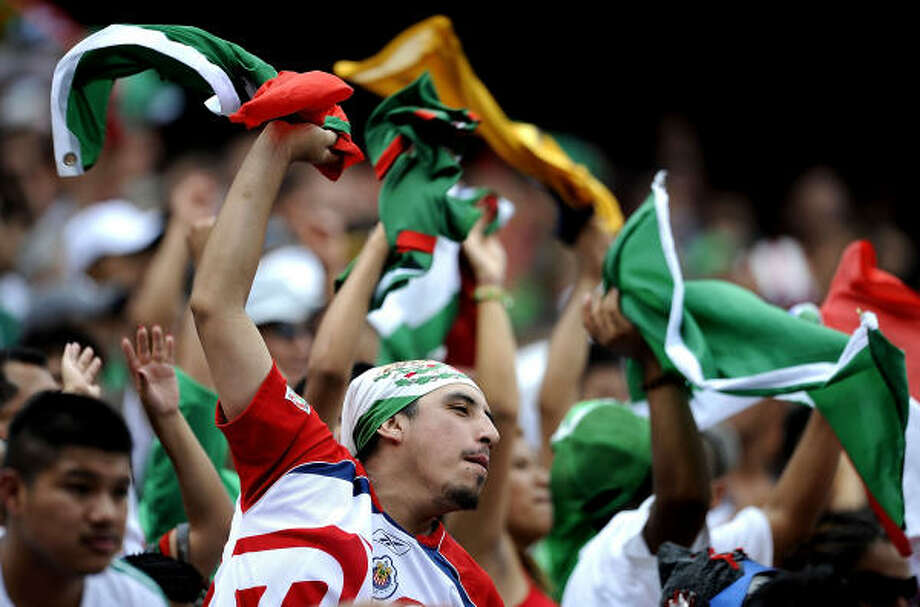 Mexico fans celebrate during the 5-0 victory over the United States. Photo: Jeff Zelevansky, Getty Images