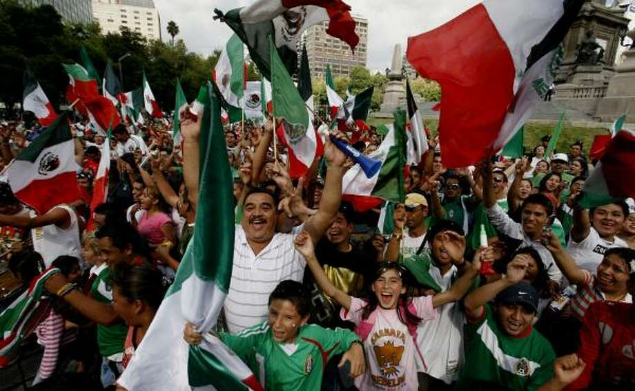 Mexican soccer fans at the Angel of Independence monument in Mexico City celebrate their team's victory. Photo: Marco Ugarte, AP