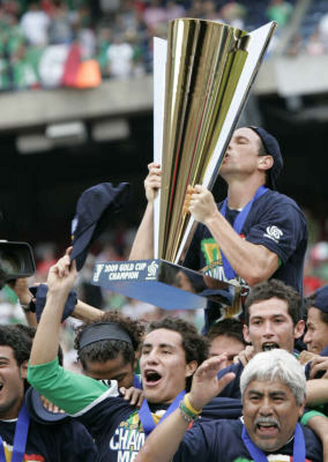 Mexico captain Garardo Torrado kisses the Gold Cup trophy. Photo: Mel Evans, AP