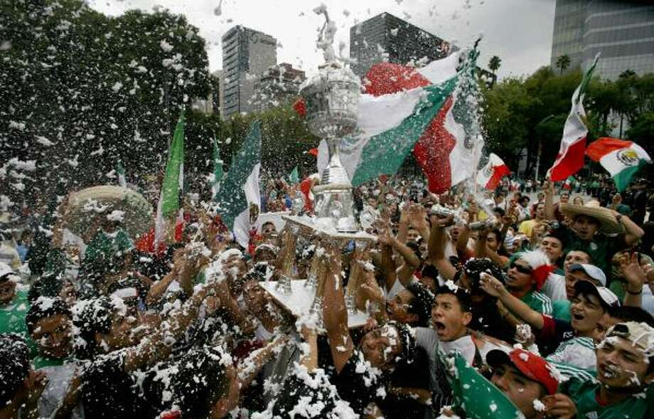 Mexican soccer fans celebrate their team's victory in the Gold Cup final. Photo: Marco Ugarte, AP