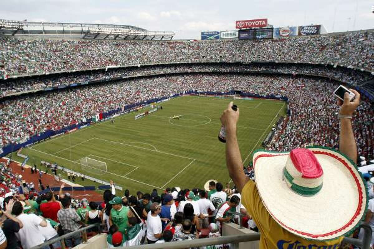 Mexico soccer fans cheer before the opening kickoff of the CONCACAF Gold Cup soccer final against the United States on Sunday.