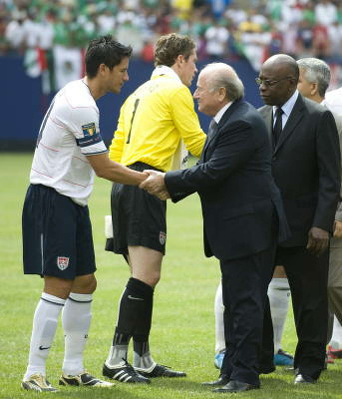 FIFA President Joseph Blatter, third from the left, greets players before the finals of the CONCACAF Gold Cup soccer tournament.