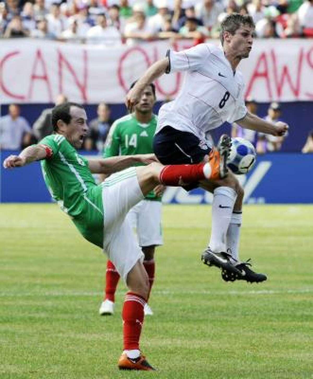 Mexico's Gerardo Torrado, left, and the United States' Logan Pause (8) battle for the ball during the first half of the CONCACAF Gold Cup soccer final.