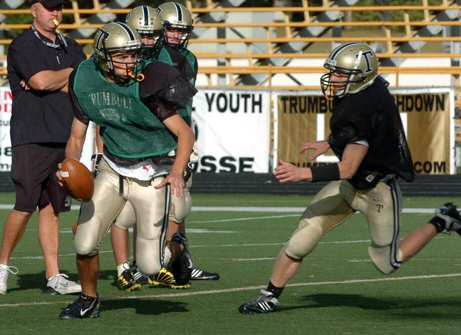 QB Brian Gallo runs through drills with his team at Trumbull High in Trumbull, Conn. on Wednesday Oct. 07, 2009. Photo: Christian Abraham / Connecticut Post