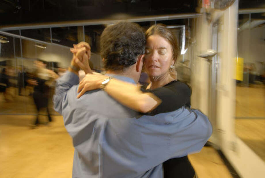 Get close: Learn to tango together. Read the story here. Photo: Tony Bullard, FOR THE CHRONICLE