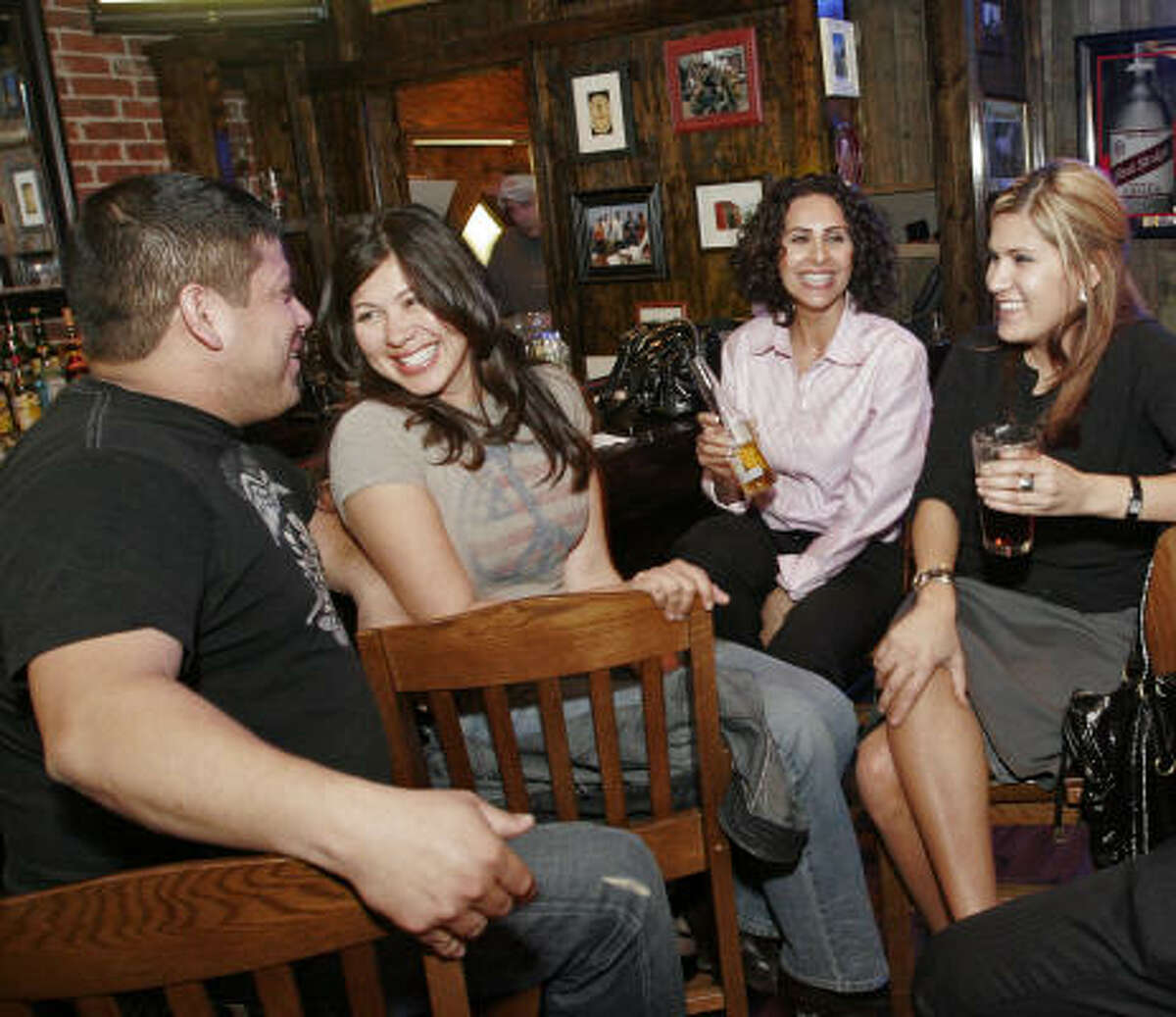 Get happy: Jorge Ortiz, from left, Denise Soto, Lilia Figueroa and Melissa Ortegon spend happy hour at the Porch Swing Pub, 69 Heights Blvd.