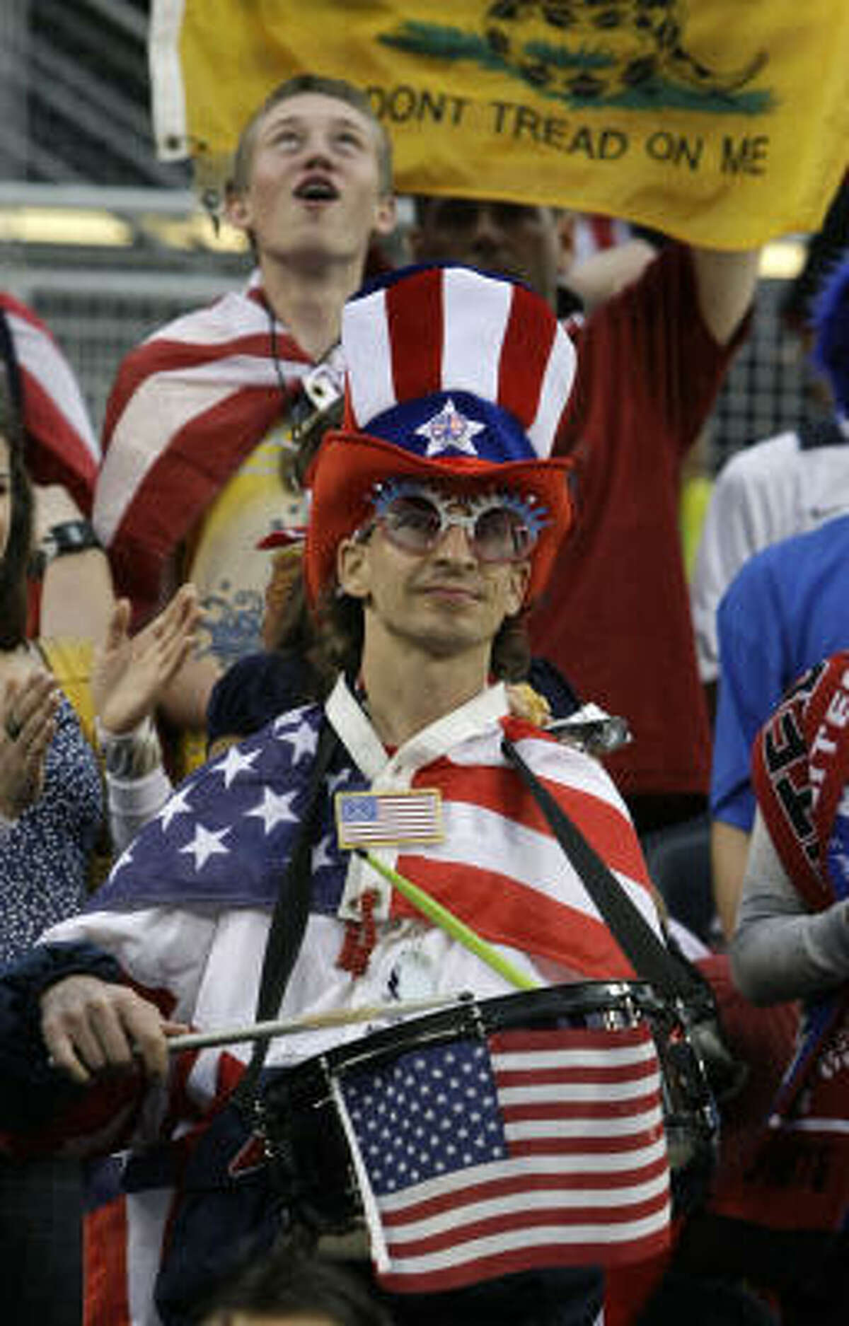 U.S. soccer fans cheer during the first half of the game.