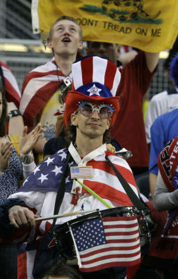 U.S. soccer fans cheer during the first half of the game. Photo: Charles Rex Arbogast, AP