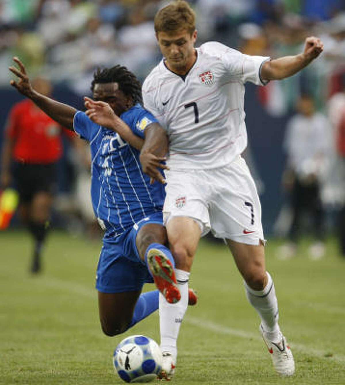 Honduras' Walter Martinez, left, strips the ball from United States' Robbie Rogers during the first half.