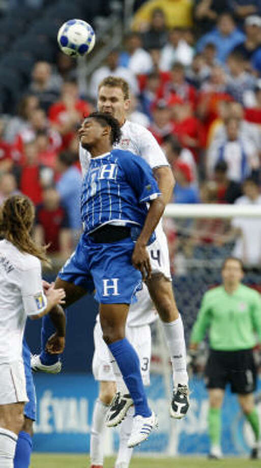 Unites States' Chad Marshall, top, and Honduras' Carlo Costly fight for a header during the first half. Photo: Nam Y. Huh, AP