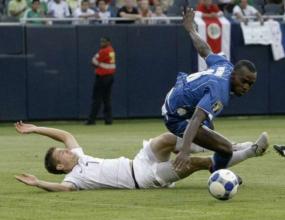United States' Robbie Rogers tackles Honduras' Nery Medina during the second half. Photo: Charles Rex Arbogast, AP
