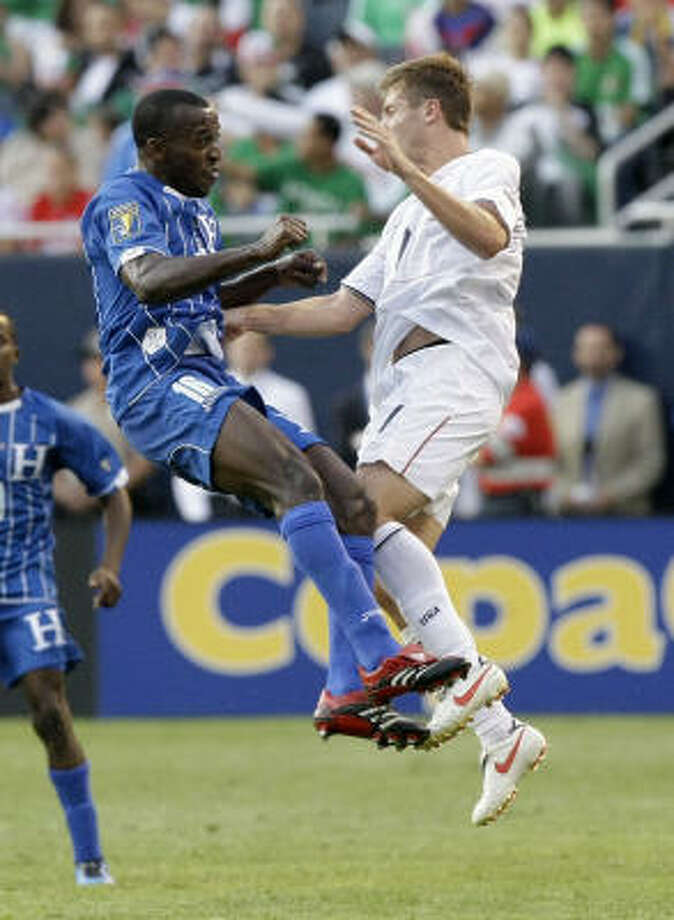Honduras' Nery Medina, left, and United States' Robbie Rogers collide during the second half. Photo: Charles Rex Arbogast, AP