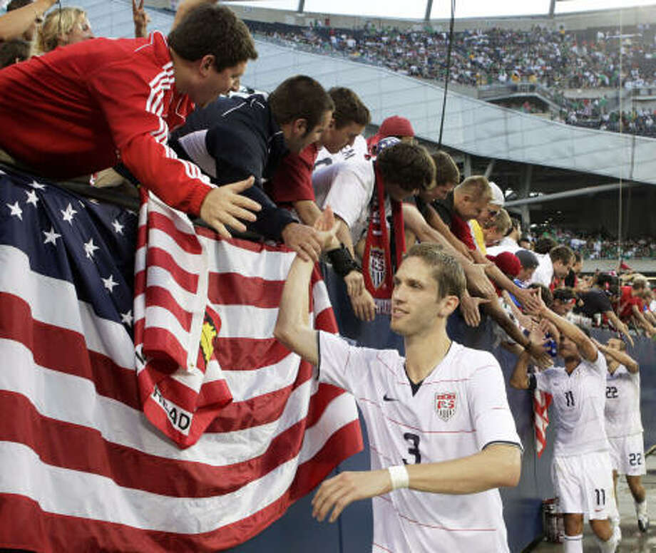 United States' Clarence Goodson high fives fans after the 2-0 win over Honduras. Photo: Charles Rex Arbogast, AP