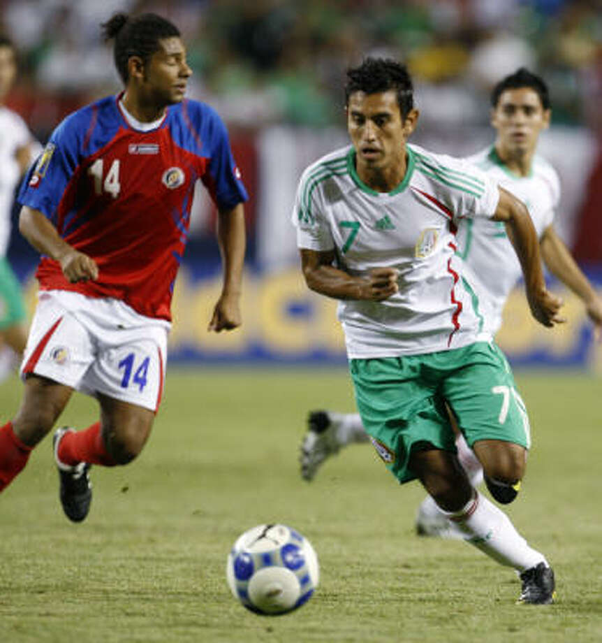 Mexico 1, Costa Rica 1 (Mexico 5-3 on penalty kicks)Mexico's Alberto Medina  dribbles around Costa Rica's Armando Alonso (14) during the first half. Photo: Nam Y. Huh, AP