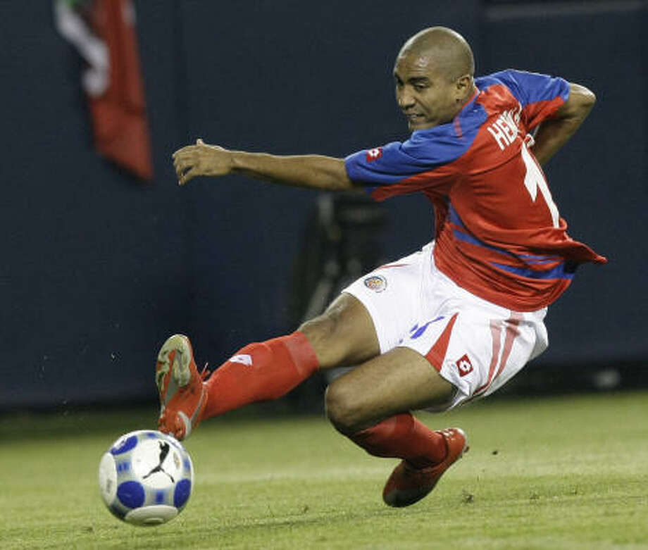 Costa Rica's Andy Herron takes a shot on goal during the first half. Photo: Charles Rex Arbogast, AP